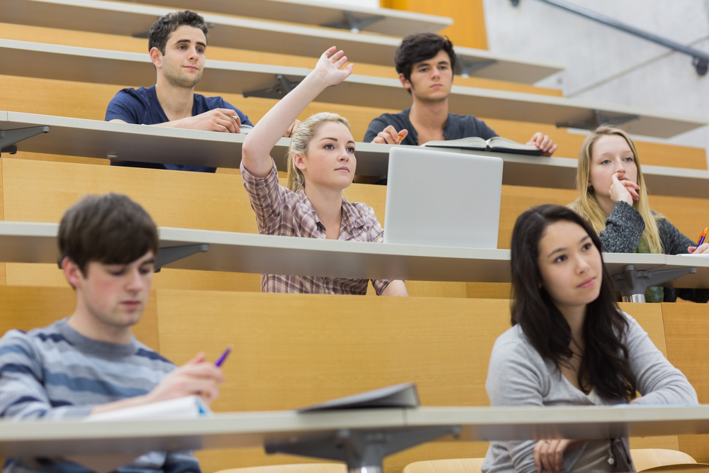 Students taking an active part in a lesson while sitting in a lecture hall-1