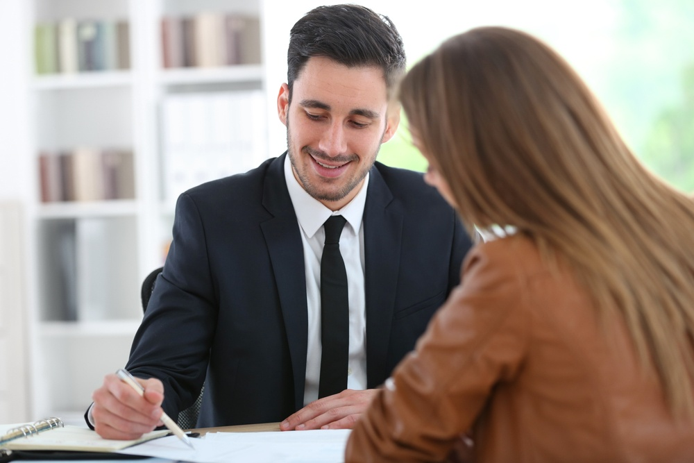 Woman meeting financial adviser in office.jpeg